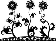 Ornamental flowers. Three black silhouette ornamental flowers Stock Images
