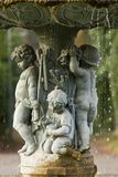 Ornamental fountain with figures of children in the garden Stock Image