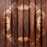 Ornamental frame on dark brown wooden fence. Abstract painted ornamental frame on dark brown wooden fence Royalty Free Stock Photography