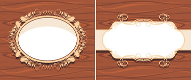 Ornamental frame on the wooden background Royalty Free Stock Image