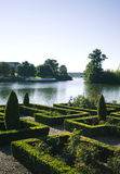 Ornamental garden. With a lake in the background Stock Image