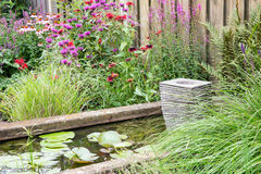 Ornamental garden with pond and little fountain Royalty Free Stock Photo