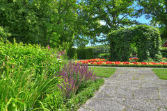Ornamental garden with stone paths. In summer Royalty Free Stock Image
