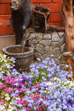 Ornamental garden water feature. Small residential paved garden water feature or waterfall stock image