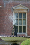 Ornamental garden water fountain. Classical water feature. Stock Photo