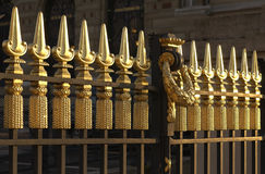 Ornamental gold leafed gate. Ornamental gold leafed wrought iron gate trellis Stock Photos