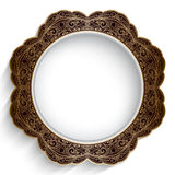 Ornamental gold plate. Antique gold decorative plate with ornamental border on white Stock Photos