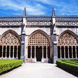 Ornamental gothic archs and garden Stock Photos