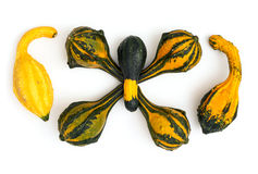 Ornamental gourds stacked on a white background Stock Photo