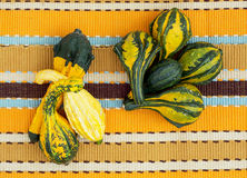 Ornamental gourds on the striped tablecloth Royalty Free Stock Photos