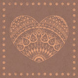 Ornamental heart. Ornamental frame on brown paper background Stock Photography