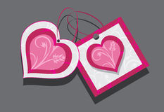 Ornamental hearts. Two tags  on the gray Royalty Free Stock Photo