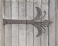 Ornamental hinges. On old wooden door Stock Images