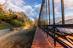 Ornamental iron fence, path and trees Royalty Free Stock Photography