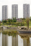 Ornamental lake with high rise buildings Stock Photography