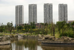 Ornamental lake with high rise buildings Royalty Free Stock Photography