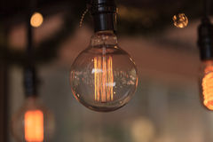Ornamental light bulb lit Stock Photos