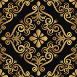 Ornamental luxury pattern design, golden color on black background Stock Photography