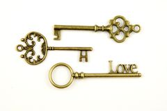 Ornamental medieval vintage keys with intricate forging, composed of fleur-de-lis elements, victorian leaf scrolls and heart shape Royalty Free Stock Image