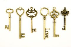 Ornamental medieval vintage keys with intricate forging, composed of fleur-de-lis elements, victorian leaf scrolls and heart shape Stock Photos
