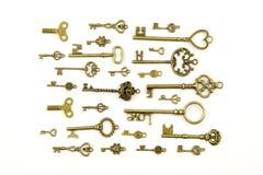 Ornamental medieval vintage keys with intricate forging, composed of fleur-de-lis elements, victorian leaf scrolls and heart shape Stock Image