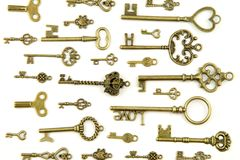 Ornamental medieval vintage keys with intricate forging, composed of fleur-de-lis elements, victorian leaf scrolls and heart shape Stock Photo