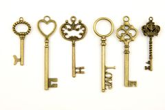 Ornamental medieval vintage keys with intricate forging, composed of fleur-de-lis elements, victorian leaf scrolls and heart shape Stock Images