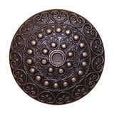 Ornamental Metal Shield. A round metal shield with decorations Stock Images