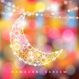 Ornamental moon with bokeh lights, Ramadan  Royalty Free Stock Photography