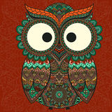 Ornamental owl on the patterned background. Royalty Free Stock Image