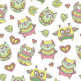 Ornamental owls seamless. Vector seamless pattern of cute ornamental owls, texture for fabric or paper print, souvenirs or babys products Stock Photos