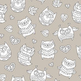 Ornamental owls seamless. Vector seamless pattern of cute ornamental owls, texture for fabric or paper print, souvenirs or babys products Stock Photo