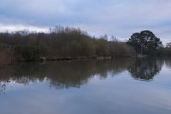 The Ornamental pond, Southampton Common. Still and a cloudy morning. Stock Photos