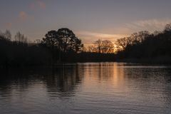The ornamental pond at sunrise: Southampton Common royalty free stock photos