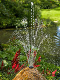 Ornamental pond and water fountain in a garden Royalty Free Stock Photography