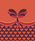 Ornamental red bow with hearts Stock Image