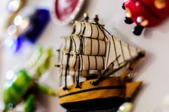 Ornamental Refrigerator Magnet Detail. Close up detail of an ornamental refrigerator magnet with the shape or a sailing ship with soft focus background Stock Image
