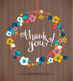 Ornamental round wreath THANK YOU. Spring floral pattern, mandala on wood texture Royalty Free Stock Photos