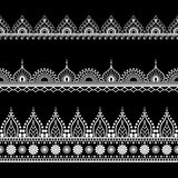 Ornamental seamless black vertical borders in henna mehndi style for tattoo or card. Stock Image