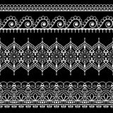Ornamental seamless black vertical floral borders in henna mehndi style for tattoo or card. Stock Images