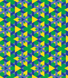 Ornamental seamless geometrical pattern of blue and yellow triangles on green background Stock Image