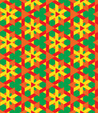 Ornamental seamless geometrical pattern of multicolor triangles on green background Stock Photo
