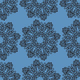 Ornamental seamless pattern on blue texture. Endless  template can be used for wallpaper, pattern fills, textile, fabric, wr. Ornamental seamless pattern on blue Royalty Free Stock Photo