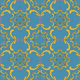 Ornamental seamless pattern. Vintage template. Blue background. Ornamental seamless pattern. Vintage template. Blue background with yellow curve elements Stock Photography