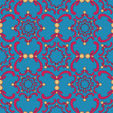 Ornamental seamless pattern. Vintage template. Red curve elements. On the blue background. Filigree texture Royalty Free Stock Images