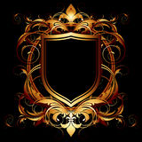 Ornamental shield on a black background Royalty Free Stock Images