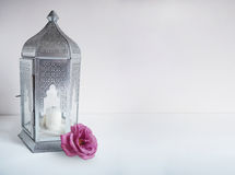 Ornamental silver Arabic lantern with rose flower on the table. Greeting card, invitation for Muslim community holy Royalty Free Stock Photo