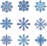 Ornamental snowflakes Stock Photos