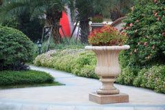 Ornamental  stone flowerpot in garden Stock Photography