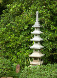 Ornamental Stone Pagoda. Stone ornament in a Japanese garden in fall Royalty Free Stock Image